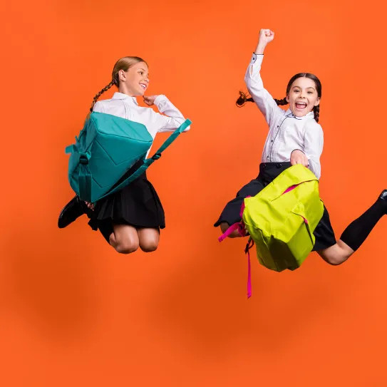 school girls jumping