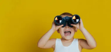 Boys binoculars yellow background